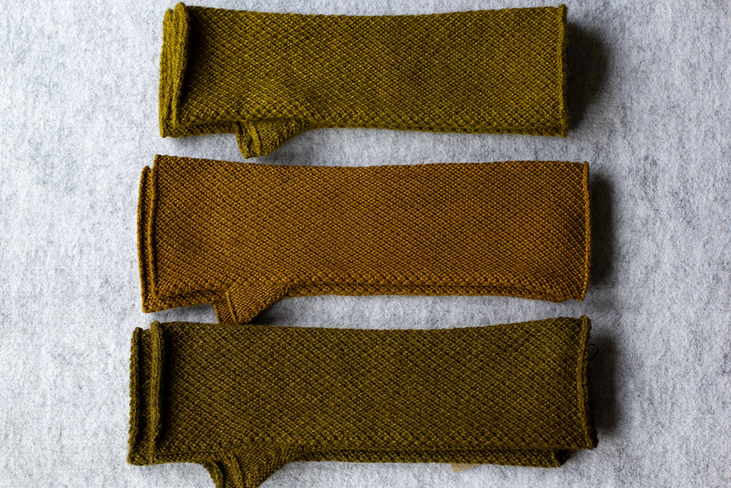 Knitted arm warmers dyed with native cherry in chartreuse colourways