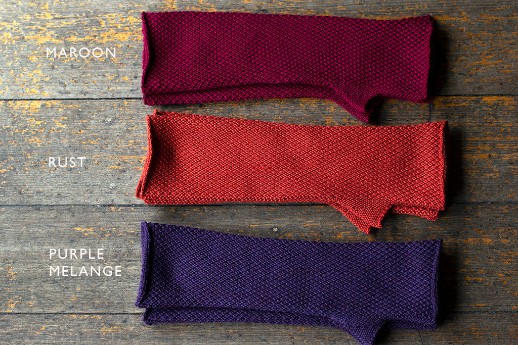 Arm warmers in maroon, rust and purple melange, made from superfine merino wool