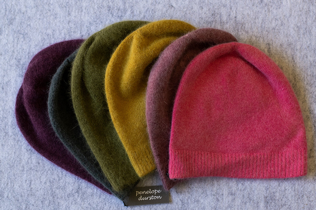 Group of colourful beanies made from angora and lambswool