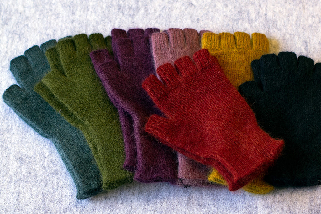 Group of colourful fingerless gloves made from angora and lambswool