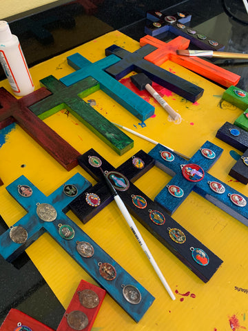 "Hand-Painted Flood Crosses, Saint Medals ""Lost in the Flood,"" but retrieved after Hurricane Katrina and carefully cleaned up and shining again, attached to hand-painted crosses"