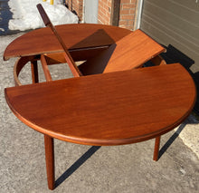 Load image into Gallery viewer, Coming***REFINISHED MCM Teak Dining Table Round to Oval Self Storing with butterfly leaf by Elliotts of Newbury