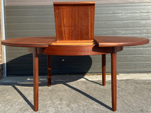 Coming***REFINISHED MCM Teak Dining Table Round to Oval Self Storing with butterfly leaf by Elliotts of Newbury