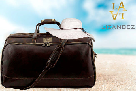 Leather Travel Bag Sitting On A Lovely Beach With A Sun Protection Hat