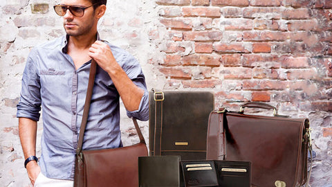 Man Posing with a range of Mens Leather Bags