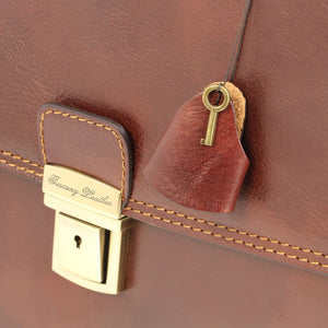 Close Up View Of The Brown Leather Briefcase Bag Key & Lock Mechanism