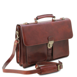 Angled And Shoulder Strap View Of The Brown Leather Attache Briefcase