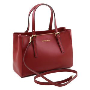 Shoulder Strap View Of The Red Aura Ruga Leather Handbag