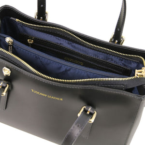 Zipper Compartment View Of The Black Ruga Handbag