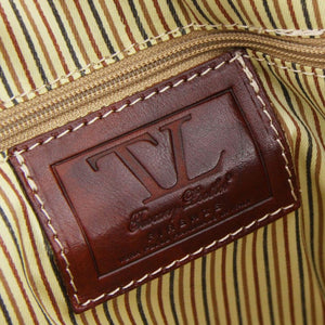 Internal Brand Name View Of One Of The Brown Leather Travel Set