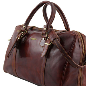 Angled View Of One Of The Brown Leather Travel Set