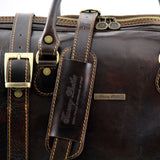 Shoulder Strap View Of One Of The Dark Brown Berlin Leather Travel Set