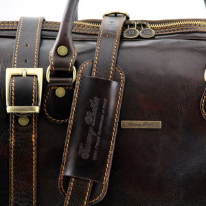 Shoulder Strap View Of One Of The Dark Brown Leather Travel Set