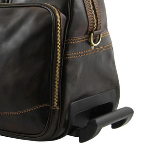 Extendable Handle Close Up View Of The Dark Brown Small Leather Trolley bag