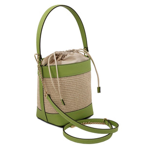 Angled And Shoulder Strap View Of The Green Bucket Bag