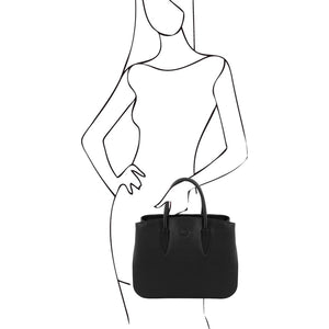 Sketch Of Women Posing With The Black Camelia Ladies Leather Handbag