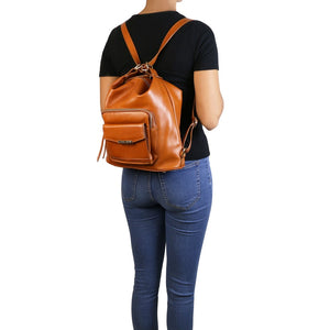 Women Posing with Backpack View Of The Cognac Convertible Leather Handbag