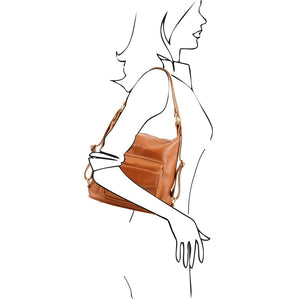 Women Posing over the shoulder View Of The Cognac Convertible Leather Handbag