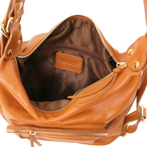 Internal Zipper Pocket View Of The Cognac Convertible Leather Handbag