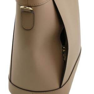 Left Side View Of The Light Taupe Demetra Leather Ruga Handbag