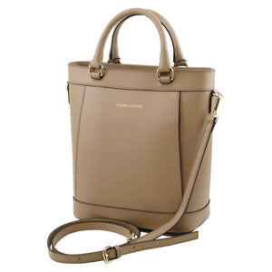 Angled View Of The Light Taupe Demetra Leather Ruga Handbag