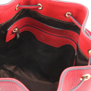 Internal Zip Pocket View Of The Lipstick Red Drawstring Bucket Bag