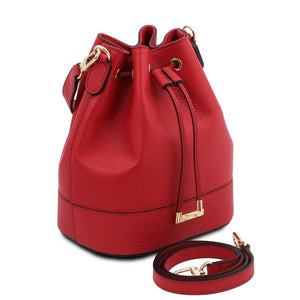 Angled And Shoulder Strap View Of The Lipstick Red Drawstring Bucket Bag