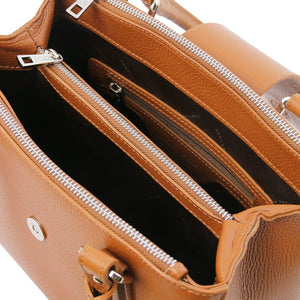 Internal Compartments And Zip Pocket View Of The Black Luxury Leather Handbag