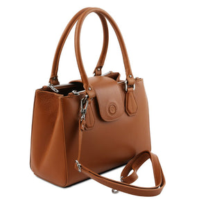 Angled And Shoulder Strap View Of The Cognac Luxury Leather Handbag