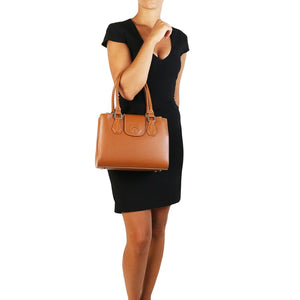 Women Posing With The Cognac Luxury Leather Handbag