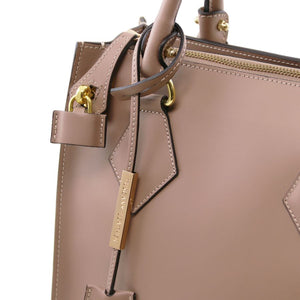 Locking Mechanism View Of The Light Taupe Fortuna Vertical Leather Handbag