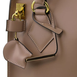 Locking And Key View Of The Light Taupe Fortuna Vertical Leather Handbag