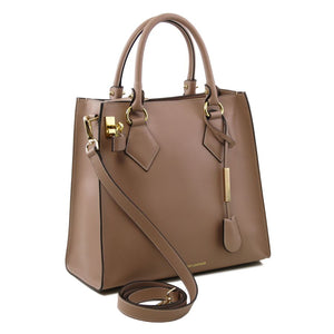 Side On View Of The Light Taupe Fortuna Vertical Leather Handbag