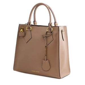 Angled View Of The Light Taupe Fortuna Vertical Leather Handbag