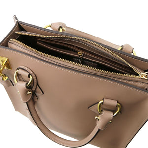 Top Zipper Closure View Of The Light Taupe Fortuna Vertical Leather Handbag