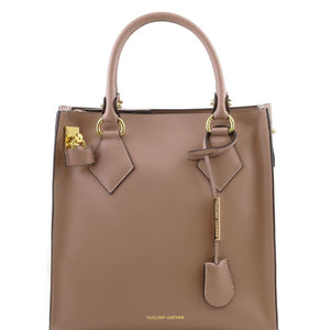 Front View Of The Light Taupe Fortuna Vertical Leather Handbag
