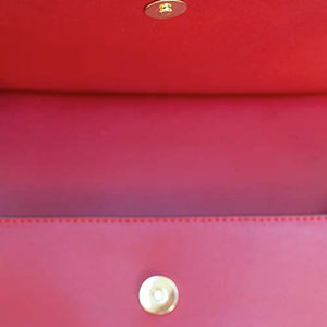 Closure View Of The Red Leather Clutch Bag