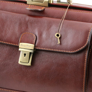 Key And Locking Mechanism View Of The Brown Double-Bottom Doctors Bag