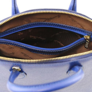 Internal Zip Pocket View Of The Small Blue Vibrant Leather Handbag