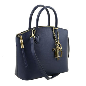 Side View Of The Small Dark Blue Tote Leather Handbag