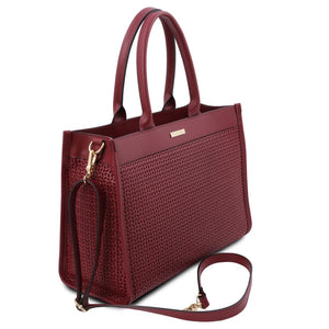 Angled And Shoulder Strap View Of The Red Ladies Shopper Bag