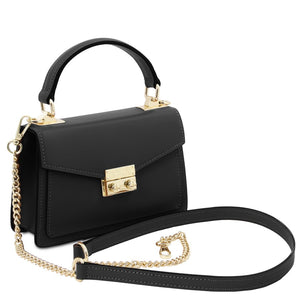 Angled And Shoulder Strap View Of The Black Leather Mini Handbag