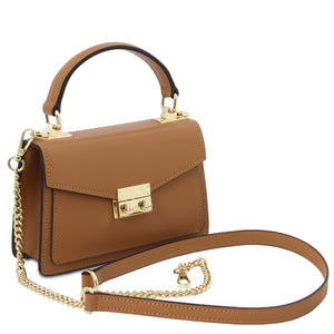 Angled And Shoulder Strap View Of The Cognac Leather Mini Handbag