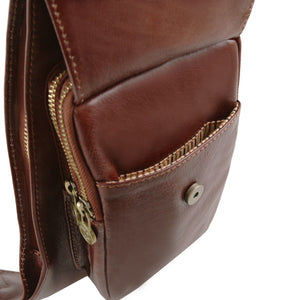 Angled Pocket View Of The Brown Leather Crossover Bag