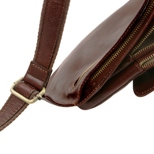 Side View Of The Brown Leather Crossover Bag