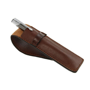 Angled View Of The Brown Leather Pen Holder With A Pen