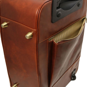 Close Up Of Rear Zip Pocket View Of The Brown 4 Wheeled Luggage