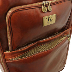 Front Pocket View Of The Brown 4 Wheeled Luggage