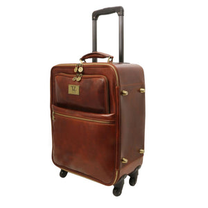Angled Retractable Handle View Of The Brown 4 Wheeled Luggage