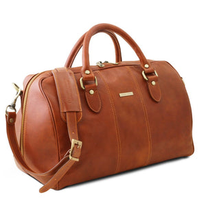 Angled View Of The Honey Leather Travel Bag Small